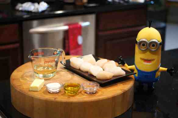 "© 2013 REMCooks.com - Baby Lady loves the little minions from ""Despicable Me."" She has been wanting her own personal minion. So, she bought Tim and insisted he help with dinner."