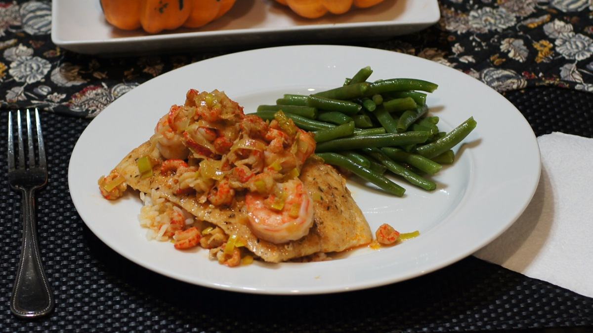 Cajun Seasoned Grouper Sous Vide topped with Crawfish & Shrimp Sauce
